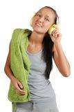 Muchacha feliz del deporte con los auriculares Imágenes de archivo libres de regalías