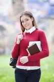 Muchacha feliz del estudiante Foto de archivo libre de regalías