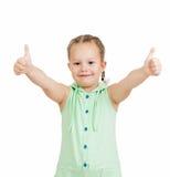 Muchacha feliz del niño con los pulgares de las manos para arriba Imagen de archivo