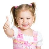 Muchacha feliz del niño con los pulgares de las manos para arriba Fotografía de archivo