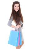 Muchacha feliz en alineada con los bolsos de compras Fotos de archivo libres de regalías