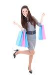 Muchacha feliz en alineada con los bolsos de compras Imagen de archivo