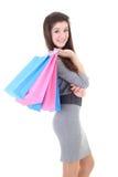 Muchacha feliz en alineada con los bolsos de compras Imágenes de archivo libres de regalías