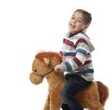 Muchacha feliz en caballo de oscilación Fotos de archivo