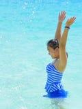 Muchacha feliz en el mar Imagen de archivo libre de regalías
