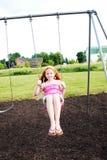 Muchacha feliz en el oscilación Imagen de archivo