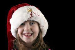Muchacha feliz en el sombrero de Santa Fotos de archivo libres de regalías