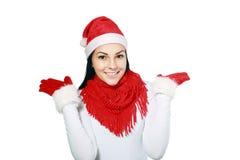 Muchacha feliz en el sombrero de santa de la Navidad Imagenes de archivo