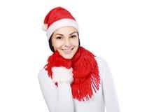 Muchacha feliz en el sombrero de santa de la Navidad Fotografía de archivo