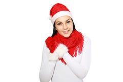 Muchacha feliz en el sombrero de santa de la Navidad Imagen de archivo
