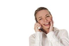 Muchacha feliz en el teléfono Foto de archivo libre de regalías