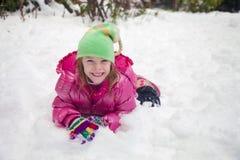 Muchacha feliz en la nieve Fotografía de archivo libre de regalías