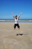 Muchacha feliz en la playa. Imagen de archivo libre de regalías