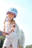 Muchacha feliz en patines en línea Imagen de archivo libre de regalías