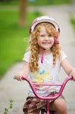 Muchacha feliz en su bici Imágenes de archivo libres de regalías