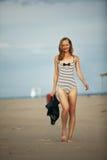 Muchacha feliz en un traje de baño rayado Fotos de archivo libres de regalías