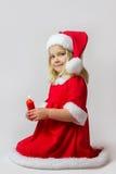 Muchacha feliz en un traje rojo del Año Nuevo Imagen de archivo