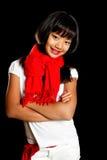 Muchacha feliz en una bufanda roja Imagen de archivo libre de regalías