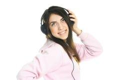 Muchacha feliz que escucha la música Fotos de archivo libres de regalías
