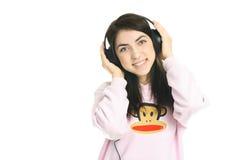 Muchacha feliz que escucha la música Imagenes de archivo