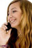 Muchacha feliz que habla en el teléfono celular Fotografía de archivo libre de regalías