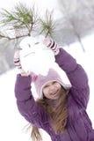 Muchacha feliz que hace el muñeco de nieve Foto de archivo