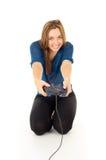 Muchacha feliz que juega al videojuego Imagen de archivo libre de regalías