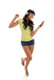 Muchacha feliz que juega el baile de la música imagen de archivo