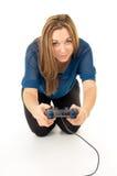 Muchacha feliz que juega a los videojuegos en la palanca de mando Fotografía de archivo