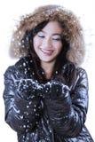 Muchacha feliz que juega nieve en estudio Imagen de archivo libre de regalías