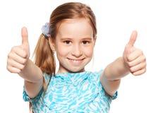 Muchacha feliz que muestra el pulgar para arriba Imagen de archivo libre de regalías