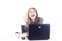 Muchacha feliz que muestra latido para arriba Imagen de archivo