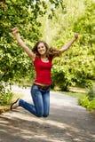 Muchacha feliz que salta al aire libre Fotografía de archivo libre de regalías
