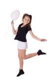 Muchacha feliz que salta con el globo Imagen de archivo libre de regalías