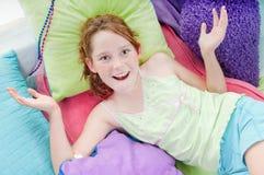 Muchacha feliz que se relaja Imagen de archivo libre de regalías