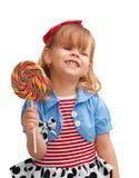 Muchacha feliz que sonríe y que sostiene el lollipop Imagen de archivo