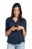 Muchacha feliz que sostiene el teléfono Imagen de archivo