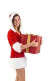 Muchacha festiva que sostiene un regalo Fotografía de archivo libre de regalías