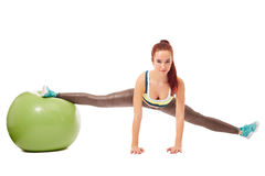 Muchacha flexible encantadora contratada a pilates Fotografía de archivo libre de regalías