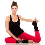 Muchacha flexible que hace estirando ejercicio de los pilates Imagen de archivo libre de regalías