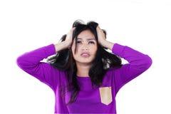 Muchacha frustrada que lleva a cabo su cabeza Imágenes de archivo libres de regalías