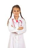 Muchacha futura del doctor con los brazos plegables Imagen de archivo