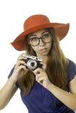 Muchacha Geeky con la cámara Fotografía de archivo libre de regalías