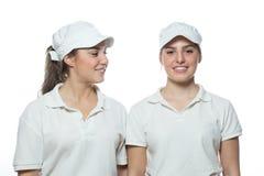 Muchacha gemela hermosa de la pizza aislada en el fondo blanco Fotografía de archivo libre de regalías