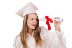 Muchacha graduada solated Foto de archivo