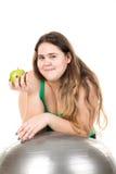 Muchacha grande con la bola del ejercicio Imagen de archivo