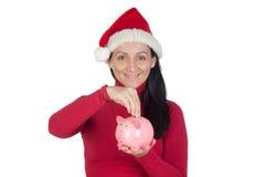 Muchacha hermosa con el ahorro del sombrero de la Navidad Fotos de archivo libres de regalías