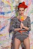 Muchacha hermosa con el lollipop grande Fotografía de archivo