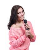 Muchacha hermosa con el micrófono aislado Foto de archivo libre de regalías