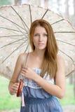 Muchacha hermosa con el paraguas Foto de archivo